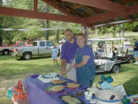 Cutting_the_cake_at_Brown_Mtn..JPG (210677 bytes)